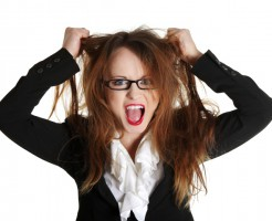 Angry woman tearing her hair